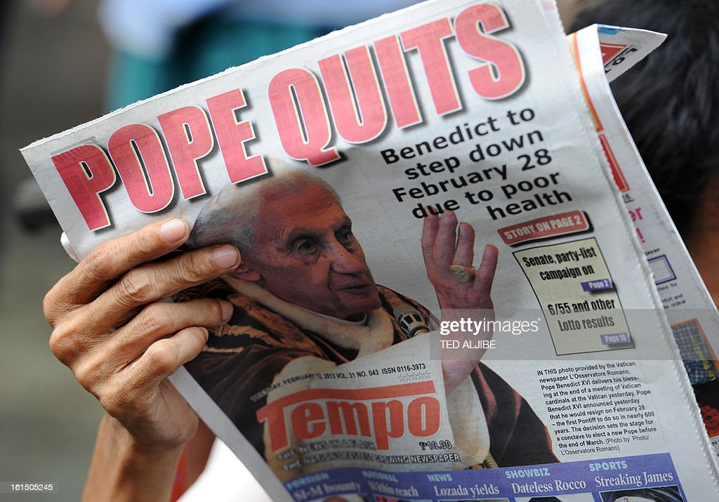 A vendor reads a newspaper featuring the story of the resignation of Pope Benedict XVI near a church in Manila on February 12, 2013. People across the mainly Catholic Philippines feel regret, gratitude and sympathy after Pope Benedict XVI announced plans on February 11 to resign, a presidential spokesman said. The Catholic Church entered uncharted waters on February 12 after Pope Benedict XVI's shock announcement that he would become the first pontiff to resign of his own free will in 700 years.