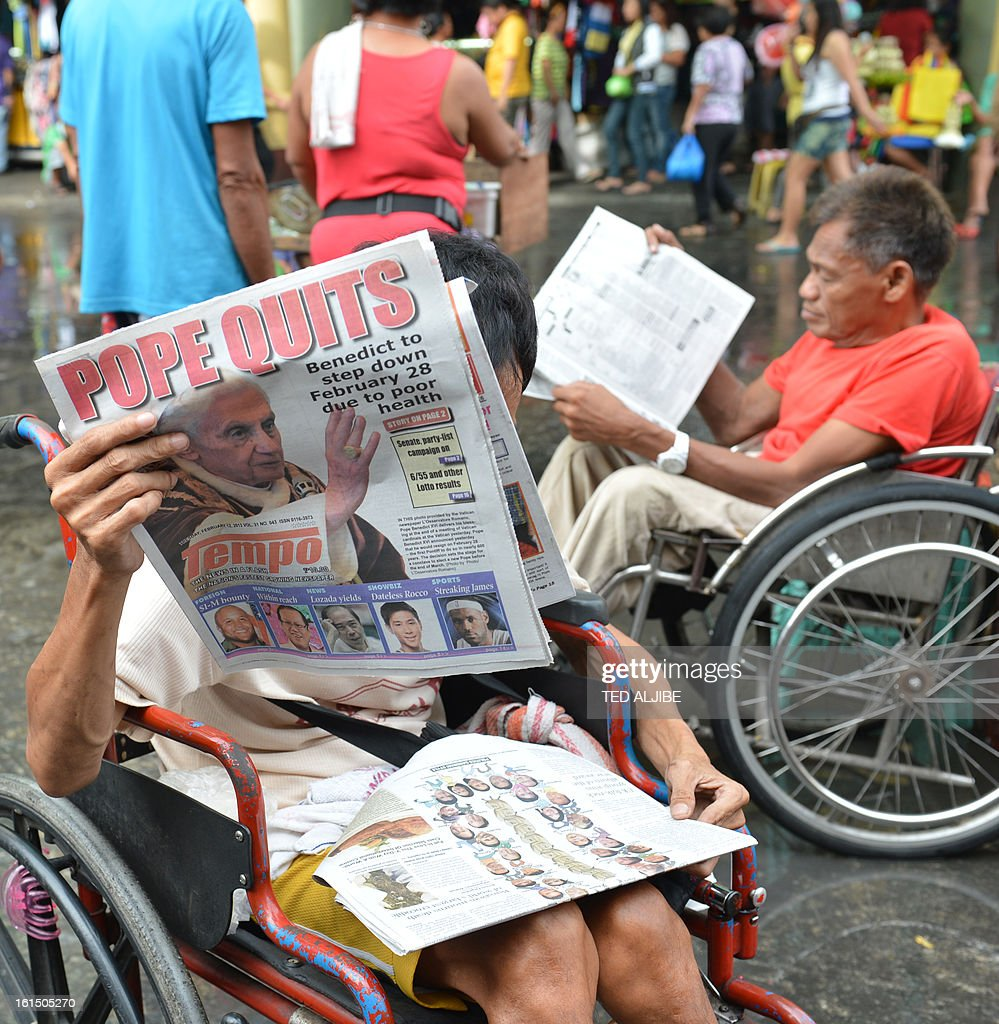 A vendor reads a newspaper featuring the story of the resignation of Pope Benedict XVI near a church in Manila on February 12, 2013. People across the mainly Catholic Philippines feel regret, gratitude and sympathy after Pope Benedict XVI announced plans on February 11 to resign, a presidential spokesman said. The Catholic Church entered uncharted waters on February 12 after Pope Benedict XVI's shock announcement that he would become the first pontiff to resign of his own free will in 700 years. AFP PHOTO/TED ALJIBE