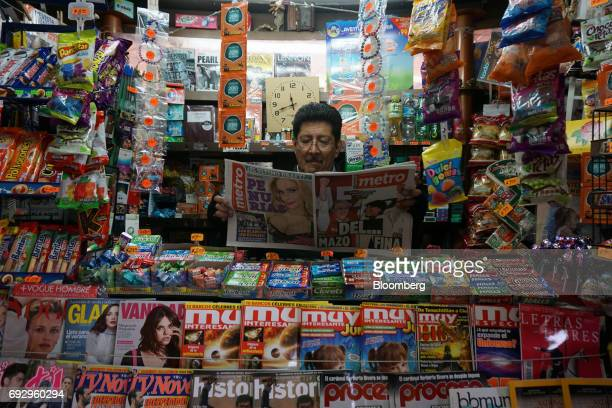 A vendor reads the Metro newspaper featuring the cover images of Alfredo del Mazo Institutional Revolutionary Party candidate for governor of the...