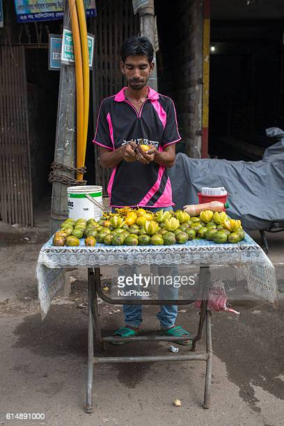 A vendor sell food on street in Dhaka Bangladesh on October 15 2016 Most of time food are being prepared with unhygienic handling And those food are...