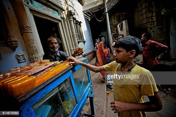A vendor selling Aam Papad in street on July 20 2013 in Varanasi India Aam papad is an Indian fruit leather made out of mango pulp mixed with...