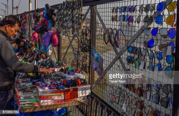 A vendor selling articles waits for customers in a market on November 06 2017 in Srinagar the summer capital of Indian administered Kashmir India...