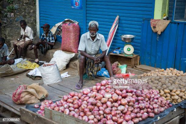 A vendor selling onions and potatoes waits for customers in the Pettah neighborhood of Colombo Sri Lanka on Thursday April 20 2017 The Central Bank...