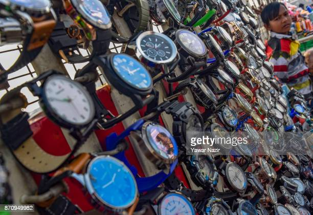 A vendor selling wrist watches waits for customers in a market on November 06 2017 in Srinagar the summer capital of Indian administered Kashmir...