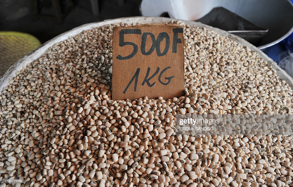A vendor sells beans in the market in Abobo, a suburb of Abidjan on July 9, 2013, first day of the Islamic holy month of Ramadan in Abidjan.