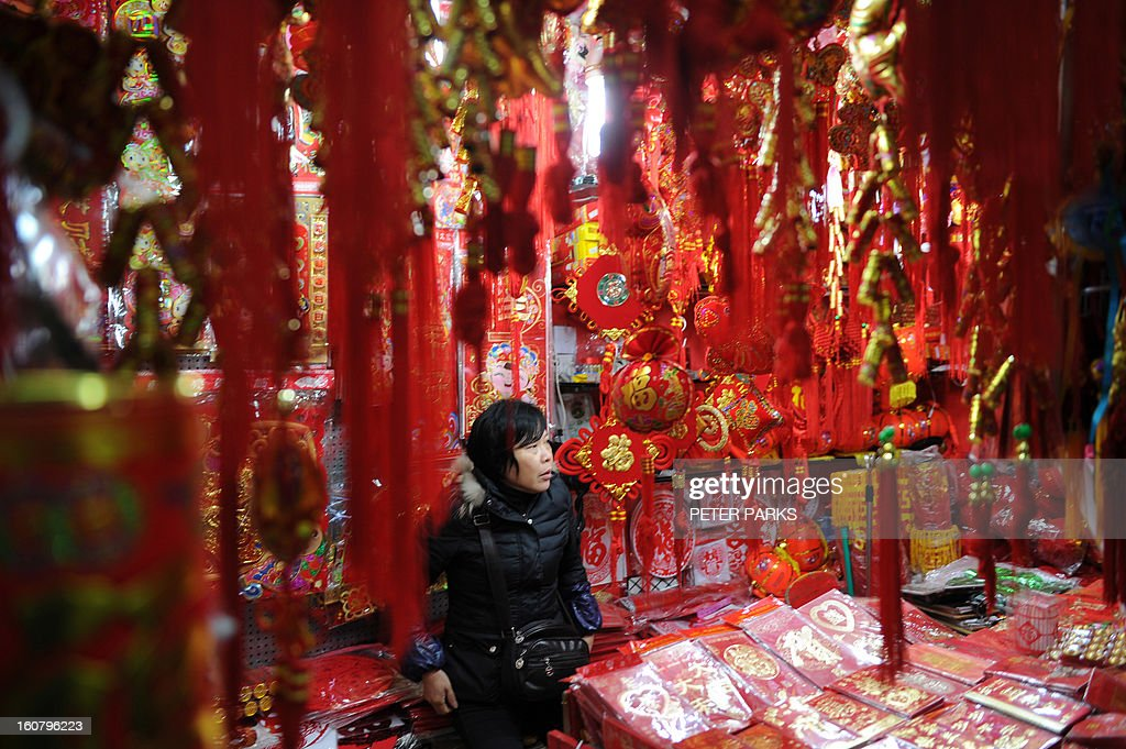 A vendor sells Chinese lanterns at a market in Shanghai on February 6, 2013 ahead of the Lunar New Year. Preparations continue for the Lunar New Year which will celebrate the Year of the Snake on February 10. AFP PHOTO / Peter PARKS