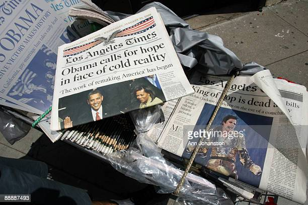 A vendor sells collectors newspapers with the inauguration of President Obama and the death of Michael Jackson on the covers outside the Michael...