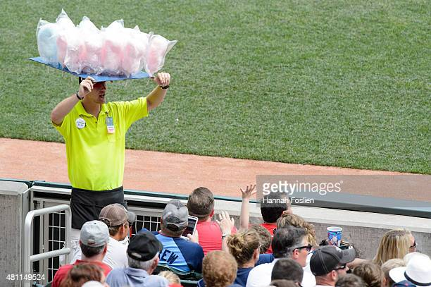A vendor sells cotton candy during the game between the Minnesota Twins and the Detroit Tigers on July 12 2015 at Target Field in Minneapolis...