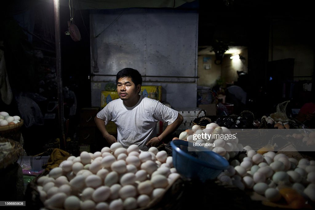 A vendor sells eggs at Kandal Market in downtown Phnom Penh, Cambodia, on Saturday, Nov. 17, 2012. U.S. President Barack Obama arrives in Phnom Penh later today to join the Association of Southeast Asian Nations (Asean) East Asia Summit, which also includes leaders from Japan, South Korea, India, Russia, Australia and New Zealand. Photographer: Will Baxter/Bloomberg via Getty Images
