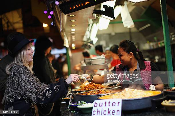 A vendor sells food in Camden Market on March 31 2012 in London England Camden in North London has been one of the city's cultural centres since the...