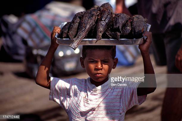 MARKET SANTAREM PARA BRAZIL A vendor sells fresh fish at a busy street market on the waterfront of Santarem a city on the Amazon River in Northern...