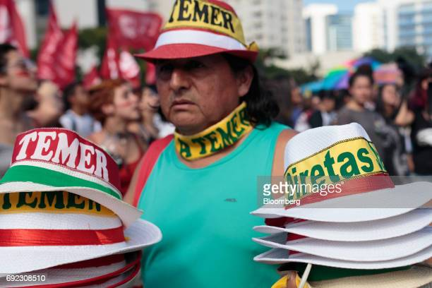 A vendor sells hats that read 'Temer Out' and 'Direct Elections Now' during a protest against Brazilian President Michel Temer and government...