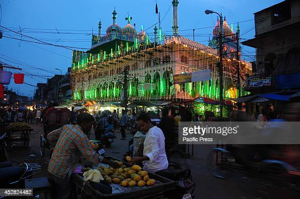 A vendor sells in front of Jama Masjid in the old city market before the Eid in Allahabad