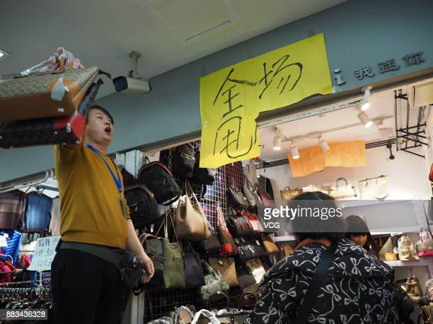 A vendor sells merchandise at the Dongding wholesale market before its closing on November 30 2017 in Beijing China The Dongding market the last of...