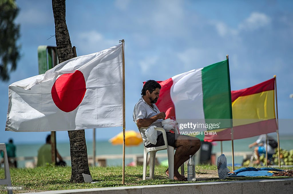 A vendor sells national flags (the Japanese, Italian and Spanish seen here from L-R) at Boa Viagem beach in Recife, northeast of Brazil, on June 19, 2013 as the FIFA Confederations Cup Brazil 2013 football tournament is being held in the country.