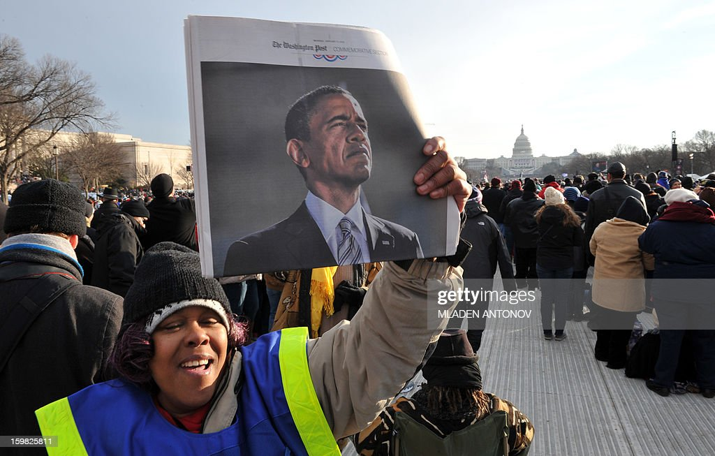 A vendor sells newspapers at the 57th Presidential Inauguration on January 21, 2013. US President Barack Obama was officially sworn in for his second term on January 20. AFP PHOTO/MLADEN ANTONOV