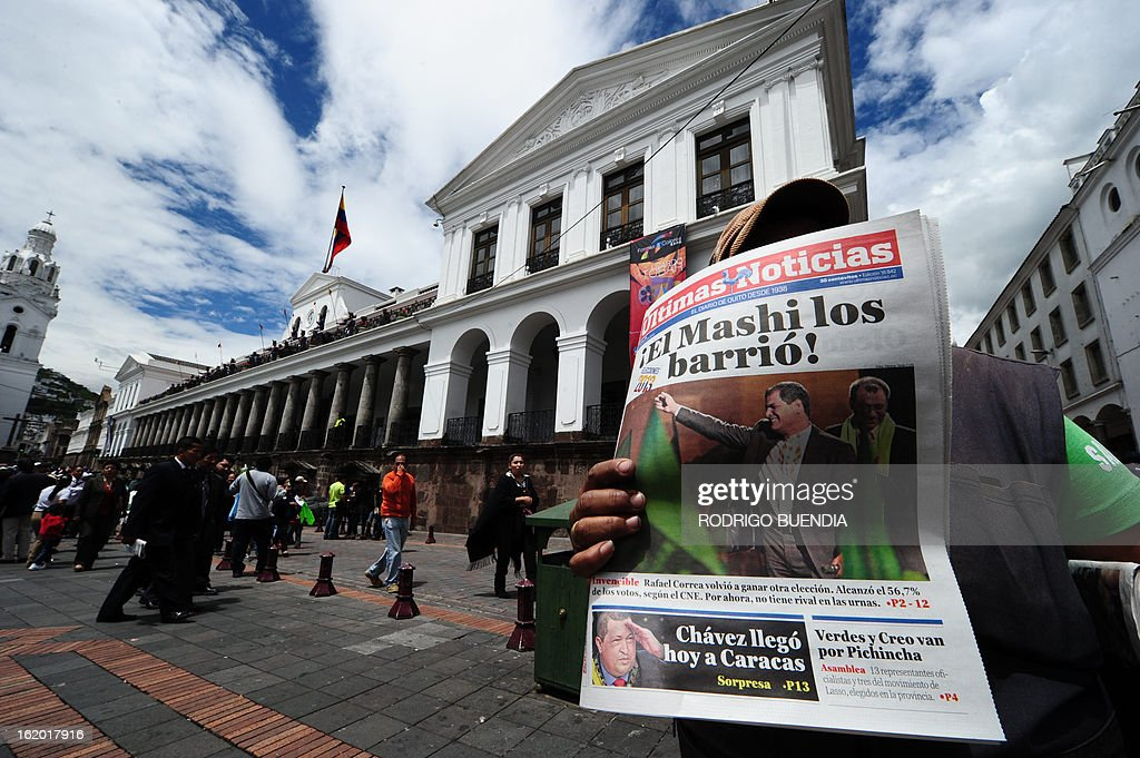A vendor sells newspapers in front of Carondelet presidential palace in Quito on February 18, 2013, a day after Ecuadorean President Rafael Correa was reelected to lead the country. Fresh from a landslide re-election victory, President Rafael Correa hoped Monday to match it with a sweeping legislative win needed to clear the way for deeper socialist changes in Ecuador.