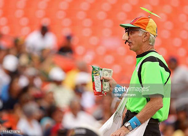 A vendor sells peanuts during a game between the Florida Marlins and the Tampa Bay Rays at Sun Life Stadium on May 20 2011 in Miami Gardens Florida