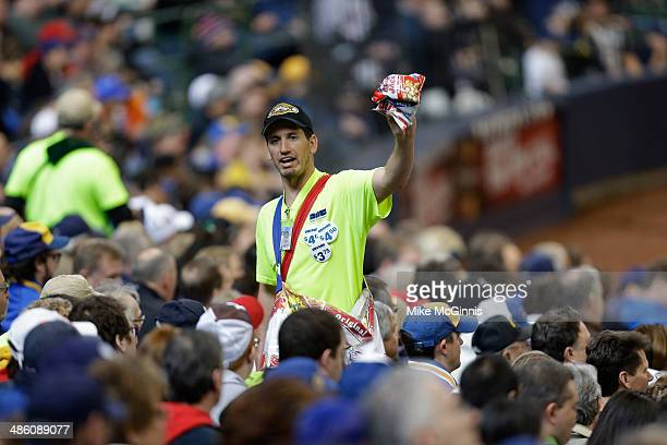 A vendor sells peanuts during the game between the St Louis Cardinals and the Milwaukee Brewers during the game at Miller Park on April 16 2014 in...
