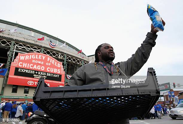 A vendor sells peanuts outside of Wrigley Field prior to game one of the National League Championship Series between the Chicago Cubs and the Los...