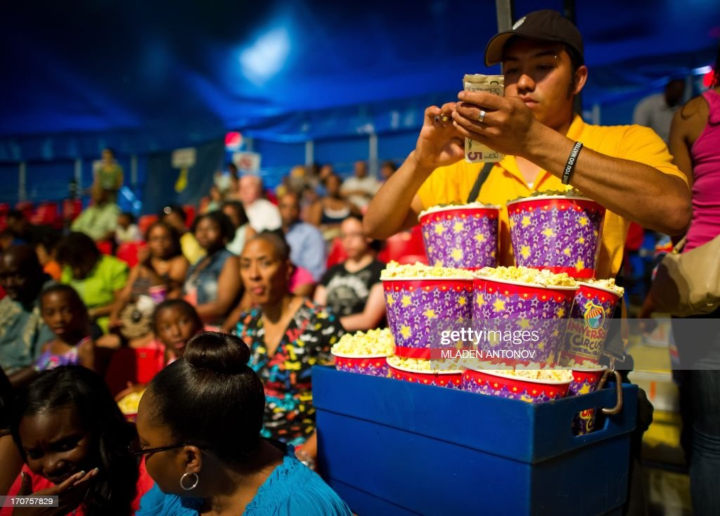 A vendor sells popcorn prior to a show of the UniverSoul Circus at National Harbor, Maryland on June 16, 2013. UniverSoul is the only African-American owned circus founded in Atlanta by concert and theater promoter, Cedric Walker. The show includes artists from the United States, Trinidad and Tobago, Colombia, France, Vietnam, South Africa, Russia, Brazil and West Africa. AFP PHOTO/Mladen ANTONOV