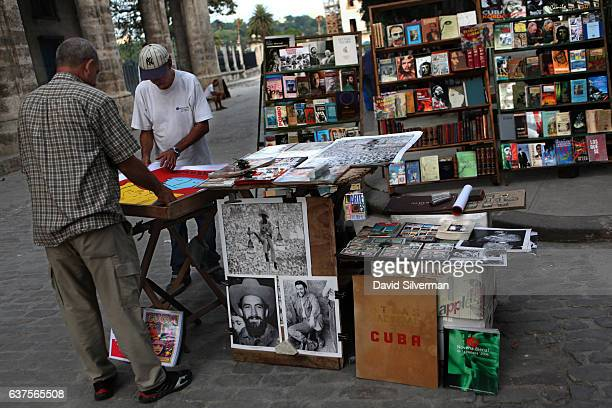 A vendor sells posters at the Plaza de Armas market on December 18 2015 in Havana Cuba The square in ciudad vieja Habana or Havana's old city dates...