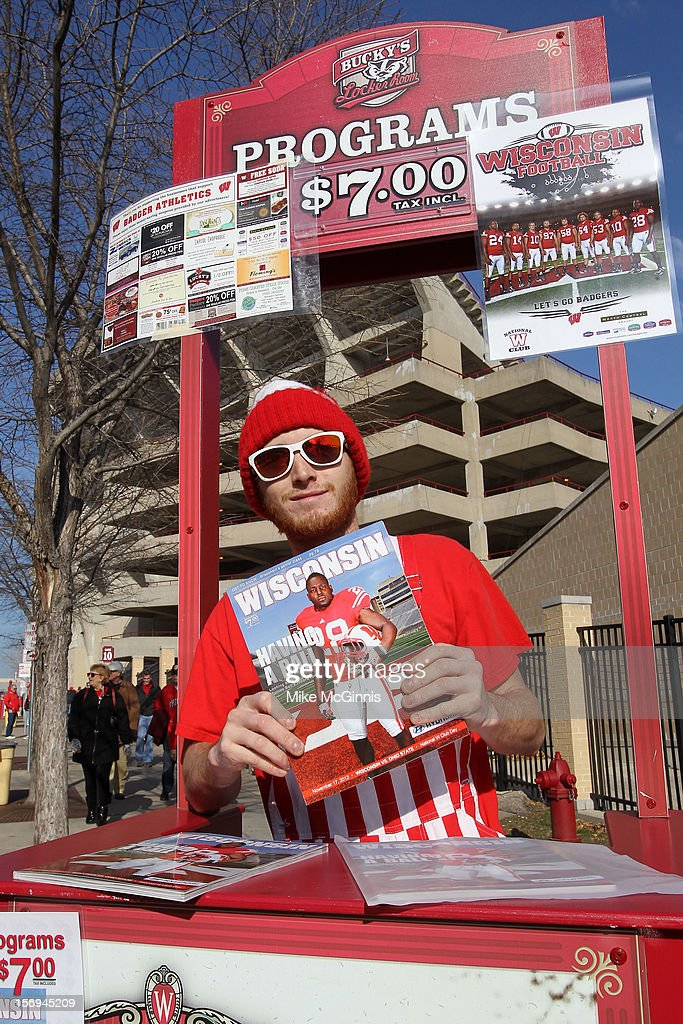 A vendor sells programs before the game between the Ohio State Buckeyes and the Wisconsin Badgers at Camp Randall Stadium on November 17, 2012 in Madison, Wisconsin.