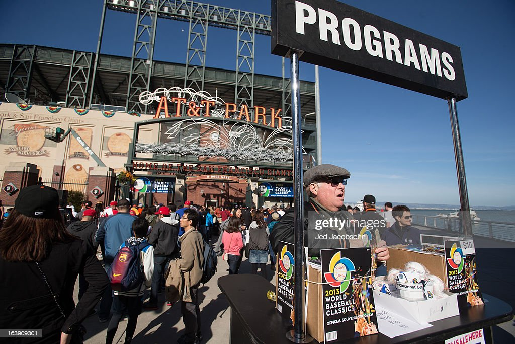 A vendor sells programs outside of AT&T Park before the semi-final game between Team Puerto Rico and Team Japan in the championship round of the 2013 World Baseball Classic on Sunday, March 17, 2013 in San Francisco, California.