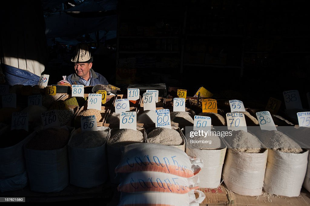 A vendor sells rice varieties from around the world at Osh bazaar in Bishkek, Kyrgyzstan, on Thursday, Nov. 8, 2012. Landlocked Kyrgyzstan is the only country in the world that hosts both Russian and U.S. military bases. Photographer: Noriko Hayashi/Bloomberg via Getty Images