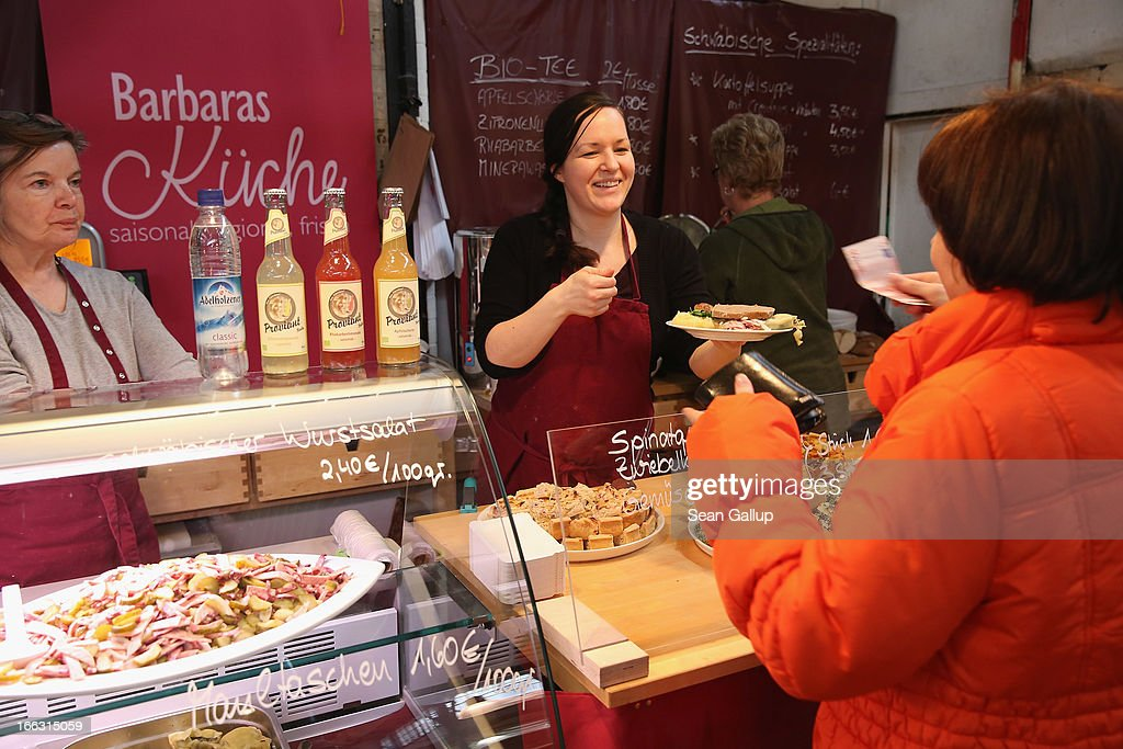 A vendor sells Schwabian-inspired delivacies, including wurst salad and spinach quiche, on the first day of Street Food Thursday at the Markthalle Neun market hall in Kreuzberg district on April 11, 2013 in Berlin, Germany. Street Food Thursday features sidewalk delicacies from a variety of culinary traditions and will be open every Thursday from 5 until 11. Berlin has become a major tourist destination in Europe and has developed a reputation as a hip, affordable and open-minded city.