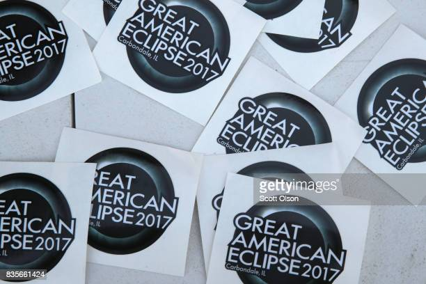 A vendor sells solar eclipse stickers on August 19 2017 in Carbondale Illinois With approximately 2 minutes 40 seconds of totality the area in...