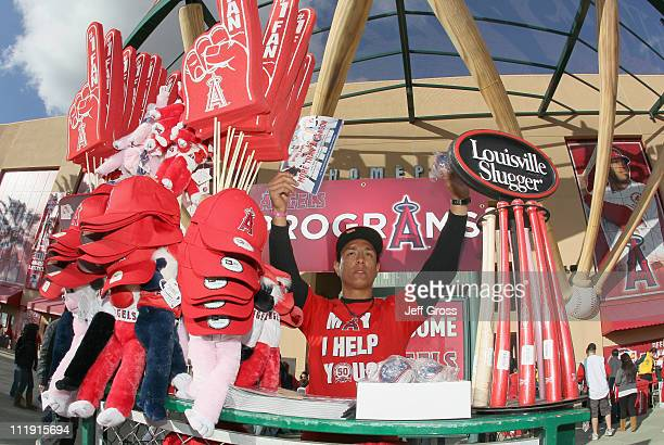 A vendor sells souvenirs prior to the start of the game between the Toronto Blue Jays and the Los Angeles Angels of Anaheim at Angel Stadium of...