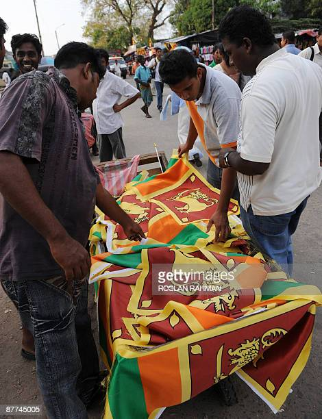 A vendor sells Sri Lankan national flags to celebrate the death of Tamil Tiger leader Velupillai Prabhakaran and the country's military victory in...