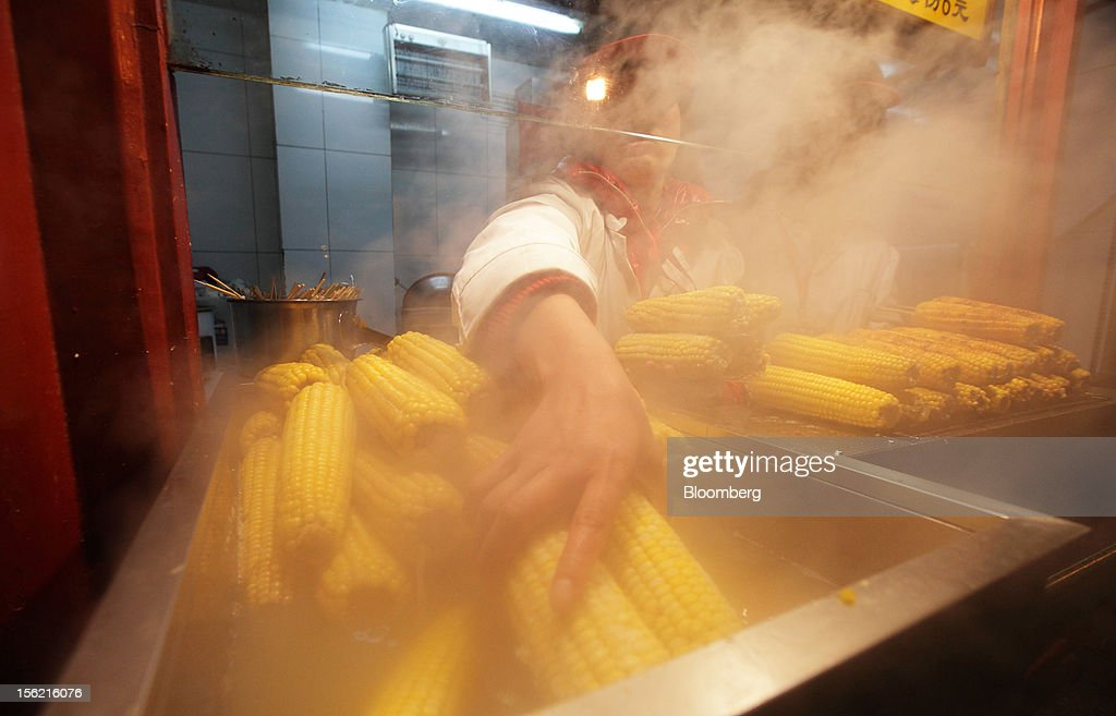 A vendor sells steamed corn at a shopping district in Beijing, China, on Sunday, Nov. 11, 2012. China's retail sales exceeded forecasts and inflation unexpectedly cooled to the slowest pace in 33 months, signaling the government is boosting growth without driving a rebound in prices. Photographer: Tomohiro Ohsumi/Bloomberg via Getty Images