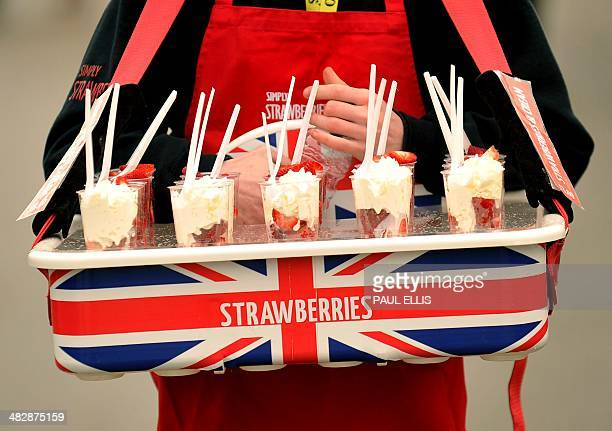A vendor sells strawberries ahead of the Grand National horse race at Aintree Racecourse in Liverpool northwest England on April 5 2014 The annual...