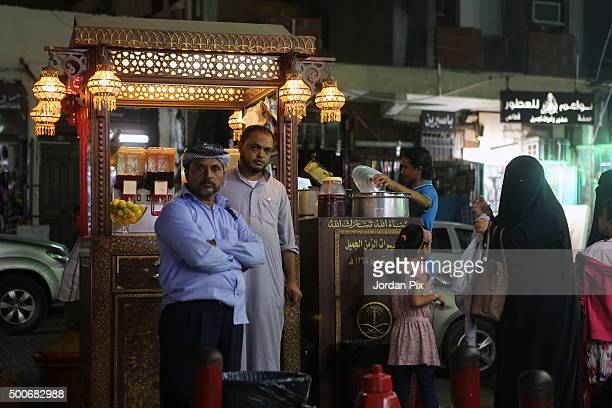A vendor sells traditional soft drinks at the popular market of Qabil street in the heart of Jeddah historic center on December 9 2015 in Jeddah...