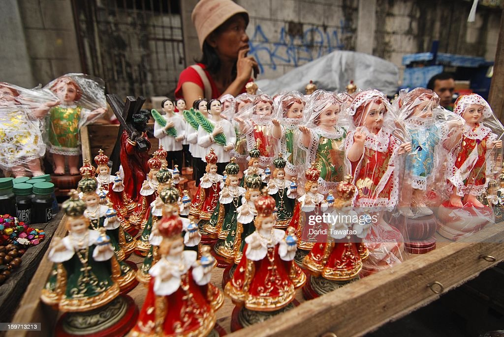 A vendor sells various figurine images of the Child Jesus during the feast of the Santo Nino grand procession in the working class district of Tondo on January 19, 2013 in Manila, Philippines. The annual Catholic celebration signals the start of festivities in various parts of the Philippines.