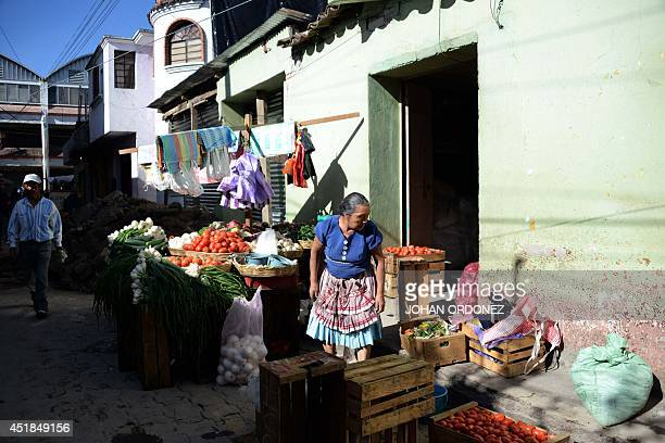 A vendor sells vegetables in San Pedro Sacatepequez municipality in San Marcos departament 240 km of Guatemala City on July 8 2014 a day after an...