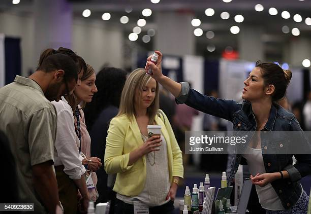 A vendor shares a sample of a cannabidiol product during the Cannabis World Congress Business Expo at the Jacob Javits Center on June 17 2016 in New...