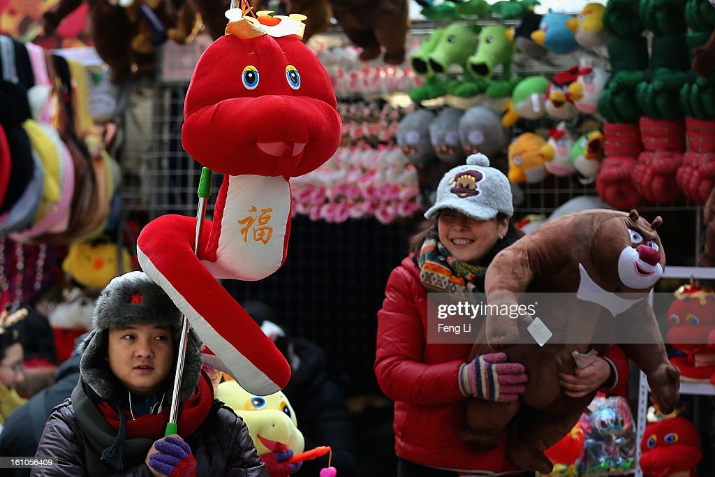 A vendor shows the toy of snake at the Spring Festival Temple Fair for celebrating Chinese Lunar New Year of Snake at the Temple of Earth park on February 9, 2013 in Beijing, China. The Chinese Lunar New Year of Snake also known as the Spring Festival, which is based on the Lunisolar Chinese calendar, is celebrated from the first day of the first month of the lunar year and ends with Lantern Festival on the Fifteenth day.