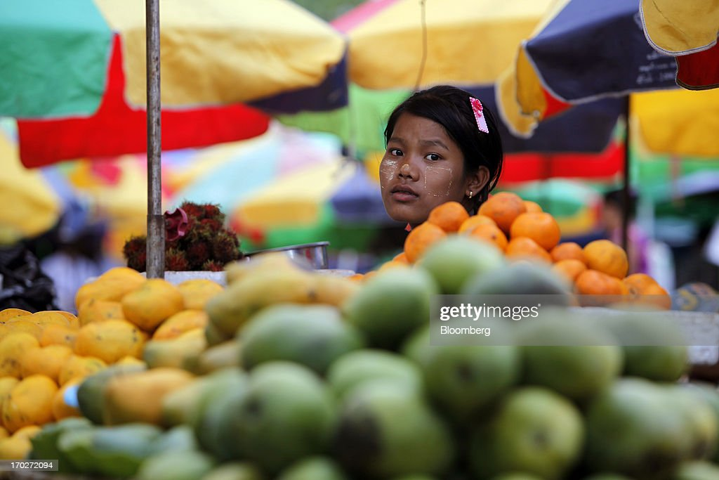 A vendor sits at a fruit stall at a market in Naypyidaw, Myanmar, on Friday, June 7, 2013. President Thein Sein has allowed more political freedom and loosened economic controls since coming to power two years ago, prompting the U.S. and other nations to ease sanctions. Photographer: Dario Pignatelli/Bloomberg via Getty Images