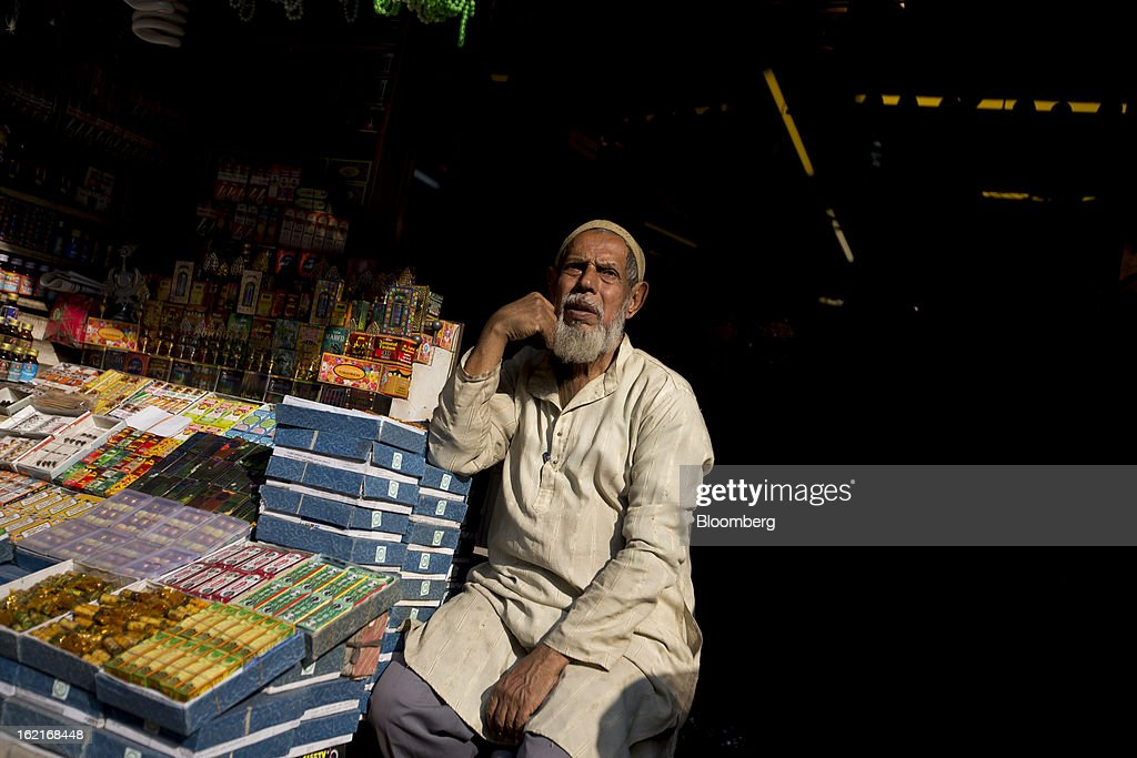 A vendor sits at a store in the Burrabazar area of Kolkata, India, on Tuesday, Feb. 19, 2013. India's slowest economic expansion in a decade is limiting profit growth at the biggest companies even as foreigners remain net buyers of the nation's stocks, according to Kotak Institutional Equities. Photographer: Brent Lewin/Bloomberg via Getty Images