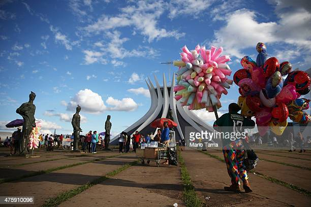 A vendor stands during the holiday of Corpus Christi outside the Cathedral of Brasilia on June 4 2015 in Brasilia Brazil The tradition is celebrated...