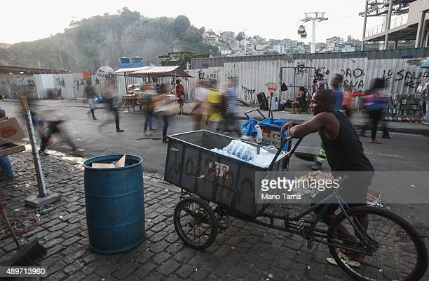 A vendor stands in front of the new gondola which travels to the top of the Providencia community or favela on September 23 2015 in Rio de Janeiro...
