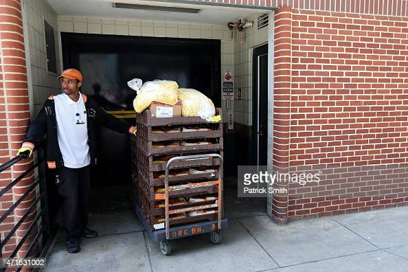 A vendor waits for an elevator after removing food from concessions before the Baltimore Orioles play the Chicago White Sox at an empty Oriole Park...