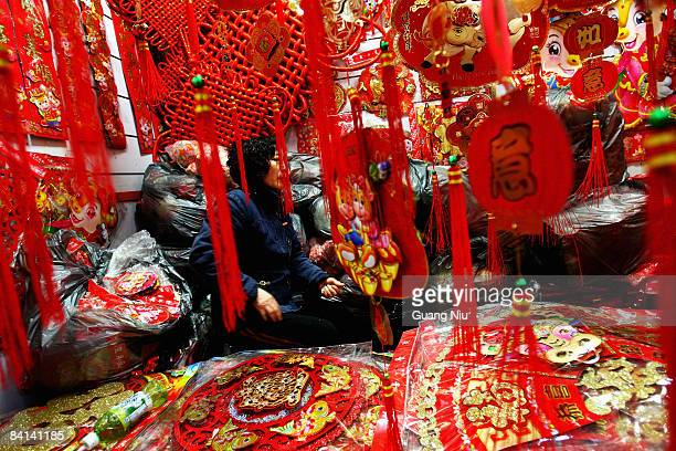 A vendor waits for customers at a New Year gifts store on December 30 2008 in Beijing China The Chinese Communist Party corruption watchdog has...