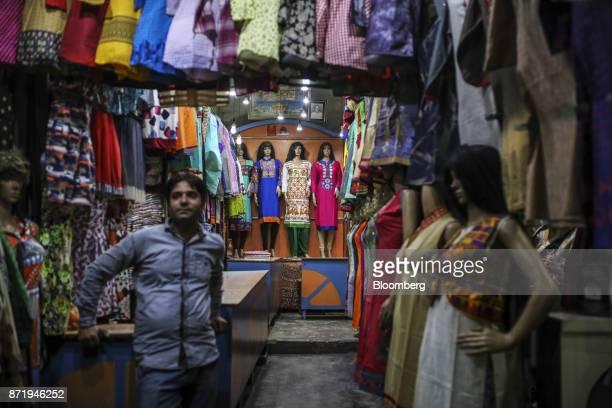 A vendor waits for customers at a saree store in Varanasi Uttar Pradesh India on Saturday Oct 28 2017 In Varanasi where the manufacture of 45meter...