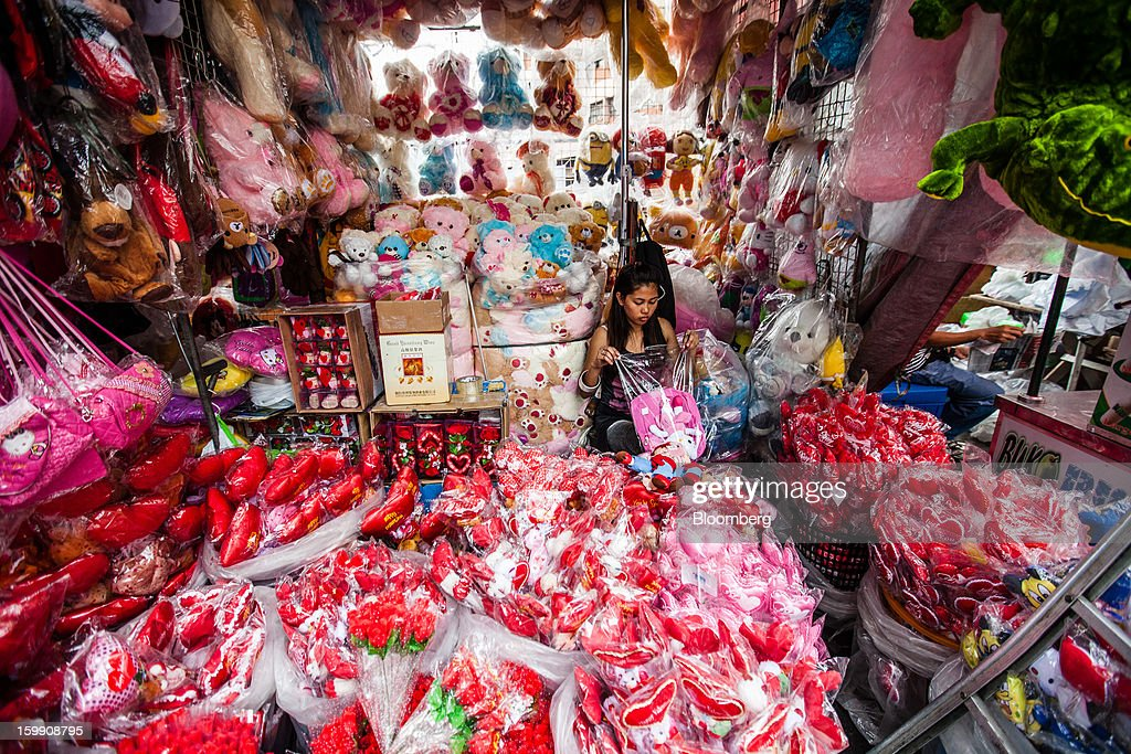A vendor waits for customers at her stall selling stuffed toys at the Divisoria market in Manila, the Philippines, on Tuesday, Jan. 22, 2013. Philippine government bonds advanced on speculation the central bank will hold its benchmark interest rate at a record low at a meeting tomorrow, supporting demand for the nation's debt. Photographer: Julian Abram Wainwright/Bloomberg via Getty Images