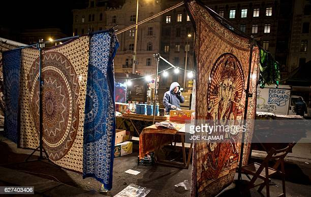 A vendor waits for customers at the Naschmarkt market in Vienna Austria on December 3 2016 Austria will hold the postponed second round of the...