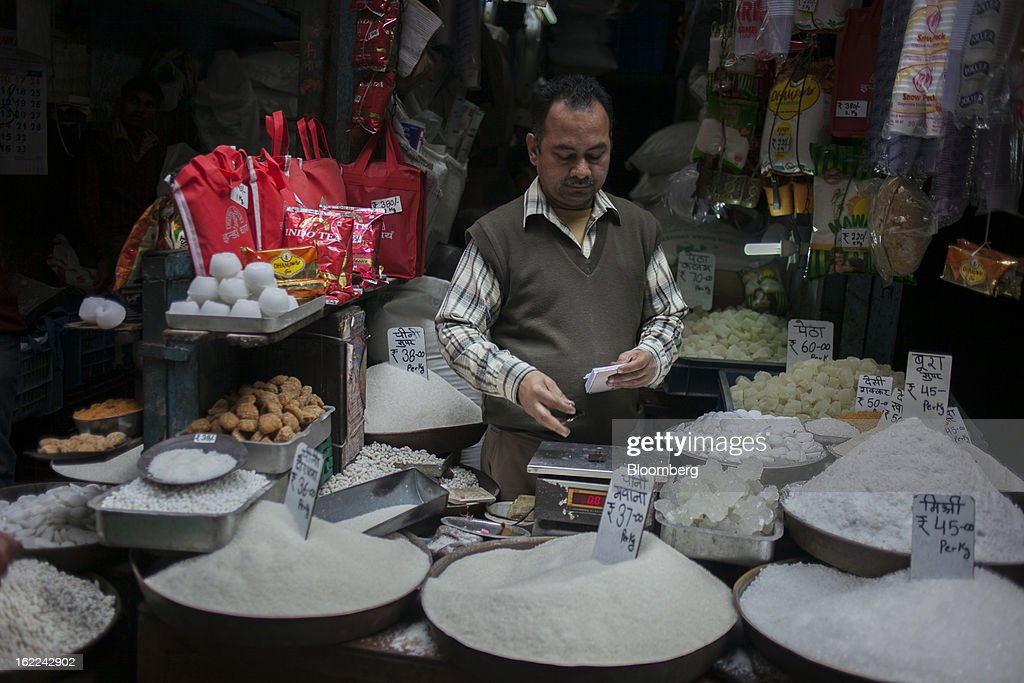 A vendor waits for customers in a store selling sugar in the Old Delhi area in New Delhi, India, on Tuesday, Feb. 19, 2013. Mills in Uttar Pradesh state, set to be India's largest sugar producer in 2012-2013, may continue cane crushing until April 30, Uttar Pradesh Sugar Mills Association President C.B. Patodia said in a phone interview. Photographer: Prashanth Vishwanathan/Bloomberg via Getty Images